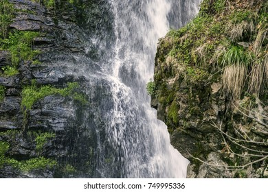 Flowing stream of water of a cascade or waterfall in Germany in springtime