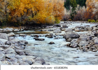 Flowing water in the Eagle River in fall, taken in Avon, Colorado.