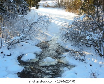 The flowing water melts the ice of the river