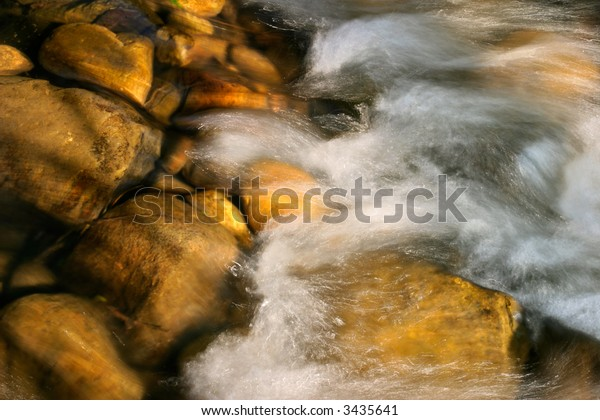 Flowing water of a mountain stream taken with a slow shutter speed