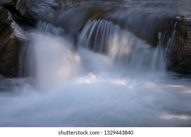 Flowing water of the rocks in mountain river / stream in Bishop, California