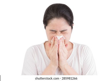 Flu cold or allergy symptom. Sick young woman girl sneezing in tissue isolate on white background. Health care. Studio shot.