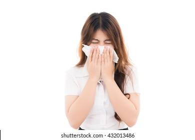 Flu cold or allergy symptom.Sick young asian woman with fever sneezing in tissue,allergies,the common cold,with blank copy space,Thai girl,Portrait of Asian woman,isolated on white background.