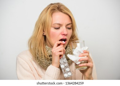 Flu and cold concept. Guidelines for treating cold. Take medications to get rid of cold. Girl take medicine drink water. Headache and cold remedies. Woman tousled hair scarf hold tablets blister.