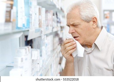 Flu is getting to him. Senior man coughing having a cold shopping medicine at the pharmacy copyspace cold sickness health issues cough sore throat seasonal concept