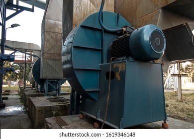 flue gas ducts behind the boiler and fans with large electric motors
