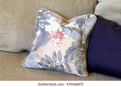 Fluffed throw pillows lay on a couch.