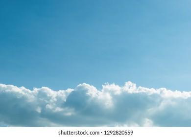 fluffy cloud above clear blue sky