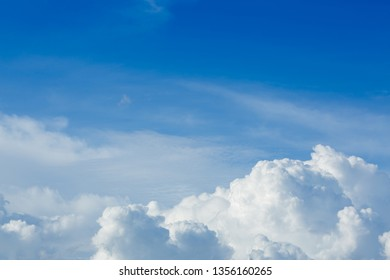 fluffy cloud above clear blue sky cloudy background