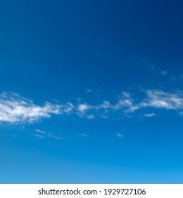 Fluffy clouds in beautiful clear blue sky