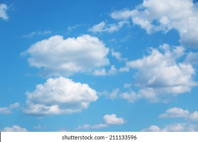 Image result for blue sky and puffy clouds