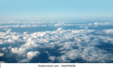 Fluffy Clouds view from airplane window