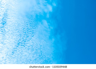 Fluffy and little clouds against with light blue sky.
