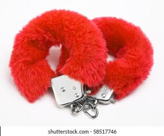 fluffy pink handcuffs on white background