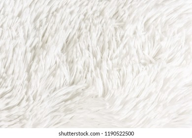 Fluffy plaid of polyester with a long heap gray. Comfortable home textiles. Background, texture