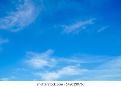 fluffy and softness white clouds floating on shade of blue sky in sunshine day