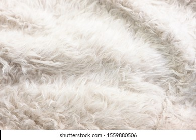 fluffy and tender natural fur background with soft folds - photo with selective focus