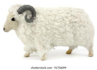 Fluffy toy ram isolated on white background