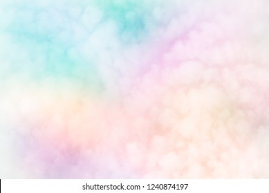 Fluffy white blurred sky clouds on abstract neon pastels of rainbow patchwork  background - Fleecy sky (Cirrocumulus - weather forecast cloud type) brings change.