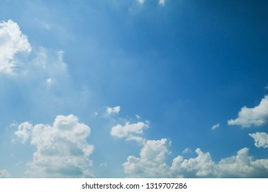 fluffy white cloud on clear blue sky