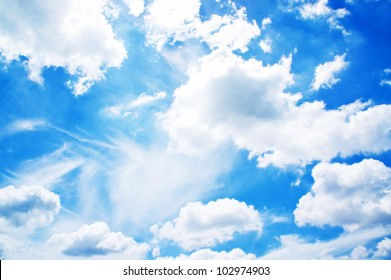 Fluffy white cloud over blue background