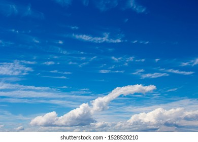 Fluffy  white cumulus clouds with some cumulostratus and cirrus formations on an autumn afternoon are contrasted against the Australian sky creating a fascinating cloud scape.
