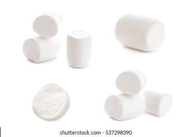 Fluffy white marshmallow macro isolated over white background. Heap of white marshmallows.