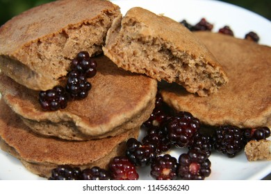 Fluffy wholesome breakfast pancakes with blackberry