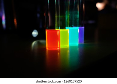Fluorescence of colloidal solutions of quantum dots. Angle view. Nanotechnology.