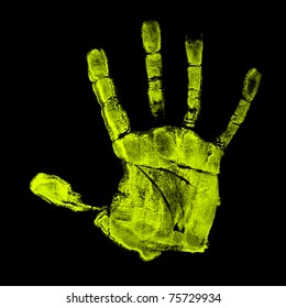 Fluorescent green hand print on black under UV light