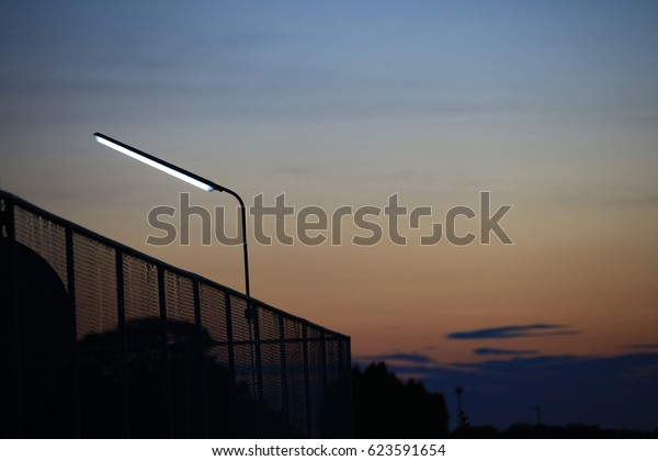 fluorescent light automatic turn on during twilight time, lighting for sport club