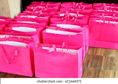 fluorescent neon pink gift bags for guests at a media event party