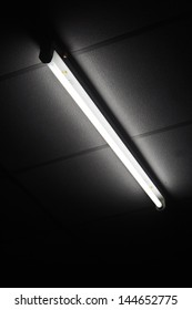 Fluorescent tube on black drop.