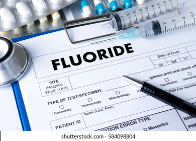 FLUORIDE Medicine doctor hand working Professional doctor use computer and medical equipment all around