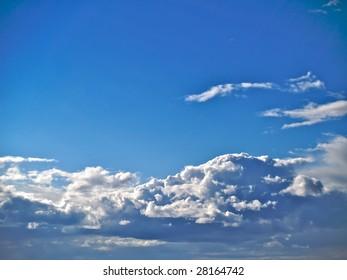 Flurry Storm cumulus on a bright blue sky