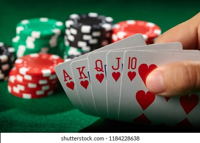 Flush royal in poker player hand. Lucky winner.