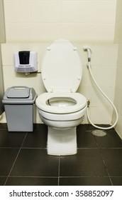 flush toilet on black floor