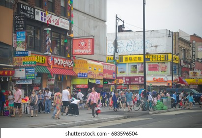 Flushing, New York - July 23, 2017: A view down a busy main street