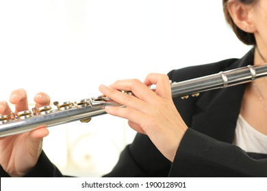 Flute classical instrument profestional player playing song. Instructor practicing bronze woodwind for orchestra as solo.