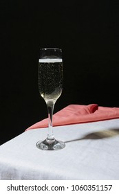 Flute filled with sparkling prosecco, on a table. Prosecco is an italian white wine cultivated between Conegliano and Valdobbiadene