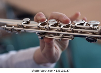 Flute in the girl's hands