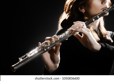 Flute instrument. Flutist hands playing flute music instrument. Closeup of flute player