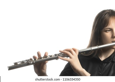 Flute instrument. Flutist playing flute isolated on white. Flute player hands