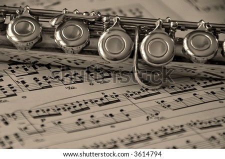 Flute Instrument On Classical Music Sheet Stock Photo (Edit Now