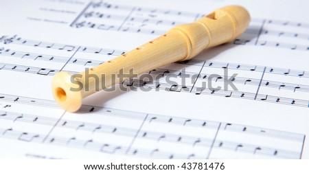 Flute Lying On Music Sheet Stock Photo (Edit Now) 43781476
