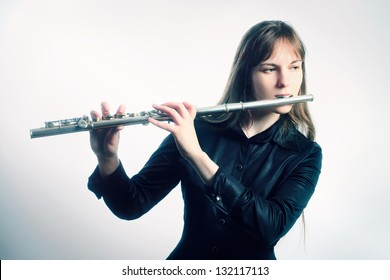 Flute music instrument flutist musician playing. Classical orchestra instruments