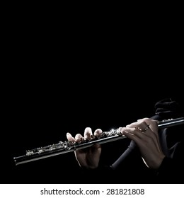 Flute music instrument hands. Flutist playing flute instrument isolated on black closeup Classical music background close up