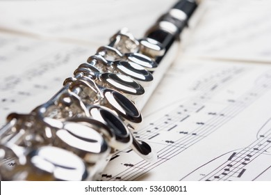 Flute on Sheet of Music
