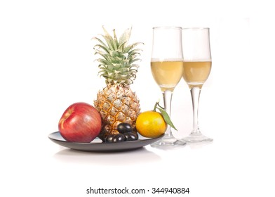flutes of champagne and fruit