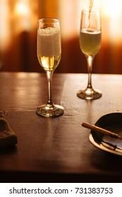 Flutes filled with Prosecco Superiore Cartizze, an italian sparkling white wine, in a restaurant in Conegliano